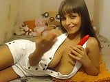 Brunette oils her big saggy tits and nipples on cam