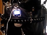 Estim in leather bondage