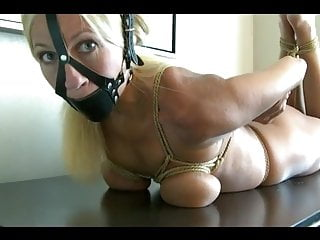 Blonde Big Tits Bondage video: Busty blonde girl tightly tied on table