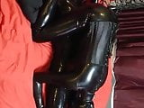 latex girl tied on bed