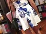 SYT in floral dress bookstore Up