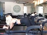 Dove Cameron working out her legs and toned ass