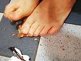 Male feet crushing food