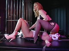 Horny mistress enjoying herself with her big tits slave