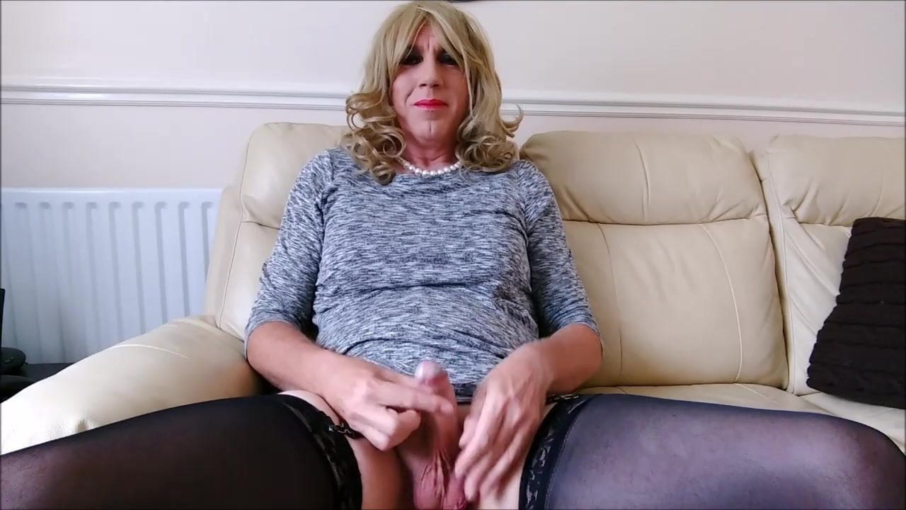 Crossdressing for the day – Caged and plug – Big Spunk
