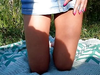 Panties under a jeans skirt on the nature