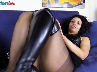 Softcore Latex Foot Fetish video: Brunette in stockings takes off her knee high boots
