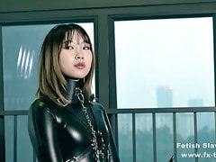 Bondage Leather Catsuit Girl On Single Gloves
