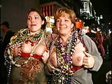 Two busty bitches flashing tits at Mardi Gras