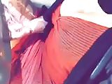 arabian girl showing off her huge tits while driving
