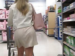 Blonde Big Ass High Heels video: Blond plump-ass PAWG in short see-thru skirt in Walmart
