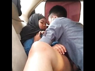 Asian Teen Blowjob video: Indonesian MILF Licked by her BoyFriend in Car