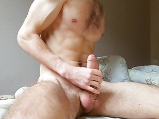 guy jerks off a big fat cock and moans