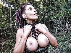 HOT BIG TITS TATTOOED BABE GIVES A BLOWJOB IN THE FOREST