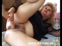 Horny granny plays with pussy
