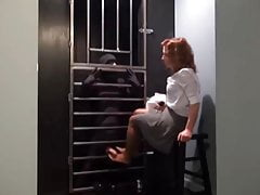 Lady warden disciplines prisoner in her private torture cell