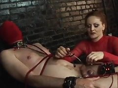 Domme And Nude Masculine Victim In Electrical City Gig Two