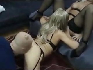 Busty blondes with their slave at home...