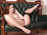 Brunette strips to sheer nylons heels showing trimmed pussy