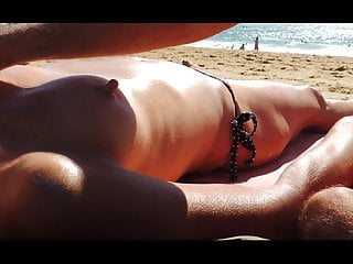 Long nipples sunmilked and erect at public beach...