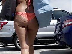 Granny at the beach in a thong bikini