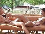 Girls making out in the garden terrace in stockings