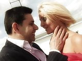 Ardent brunette groans in pleasure getting shagged doggystyle against her desk