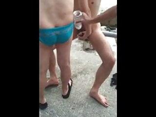 group-piss-at-beach