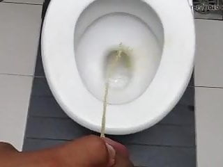 Pissing in a restaurant toilet