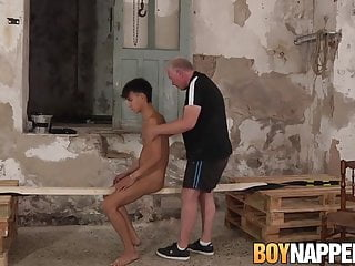 Twink is wrapped up as his master strokes his cock wildly