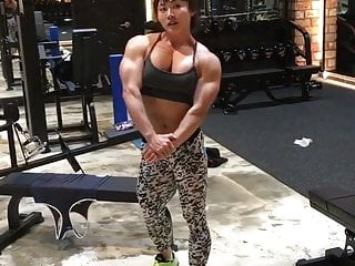 Muscle mature asian woman...