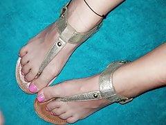Cumshot on her feet in sandals