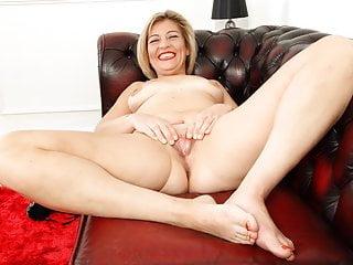 Filthy emma rubs her fanny on sofa...