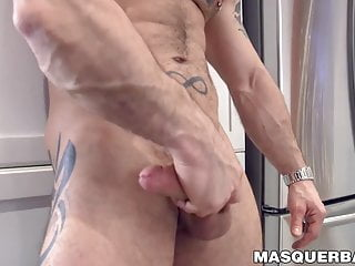 Muscular tattooed strokes his huge cock solo...