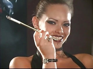Hd Videos video: Sexy Leather Mistress smoking with holders