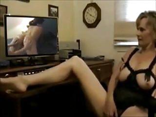 Mature wife masturbates while porn...