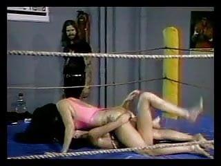 Girls cat fighting on mattress