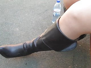 Stockings and black leather boots outdoor