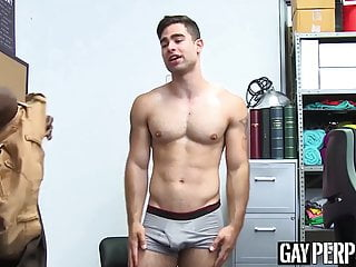Restrained straight jock barebacked by black security guard