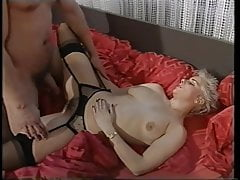 Blond Heike with short hair in black nylons