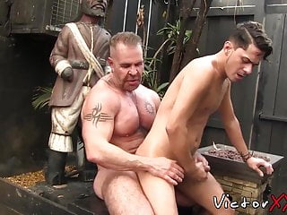 Muscular daddy lets bottom out of cage for...