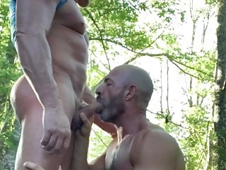 Two mature men have fun in the woods