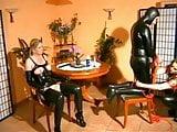 Latex Mistress fucks sub couple