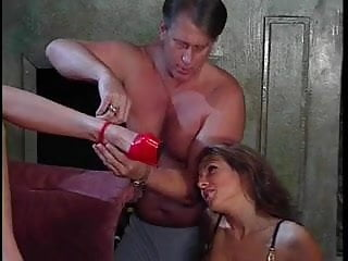 Businessman licking two sluts feet