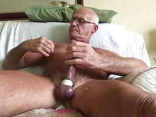 Nice tanned grandpa plays with himself with dildo up his ass