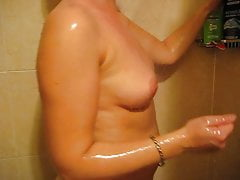 Young wife taking shower...
