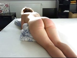 Young lady is spanked with the cane