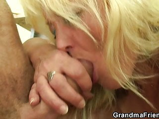 Old blonde teacher swallows two young cocks at once