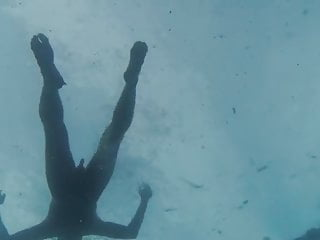 Swimming naked in the sea. Very erotic.