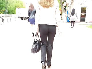Young woman ass in black pants